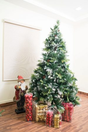 8 ft Woodbridge Fir Christmas Tree with berries and cones